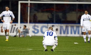 Inter players stand dejected