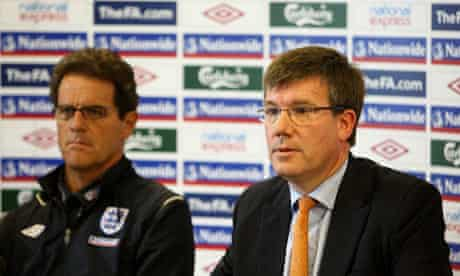 Ian Watmore, right, sits with Fabio Capello during a press conference in June 2009