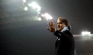 Manchester City manager Roberto Mancini waves at fans