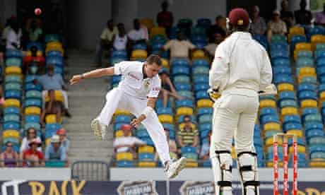 Dale Steyn, left, jumps out of the ball's way as Shane Shillingford of the West Indies looks on