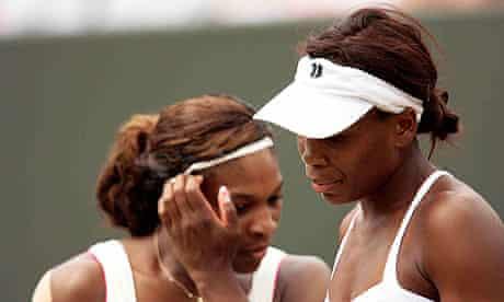 Serena, left, and Venus Williams during their doubles defeat to Elena Vesnina and Vera Zvonareva