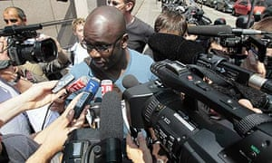 Lilian Thuram speaks to journalists at the FFF's headquarters in Paris today