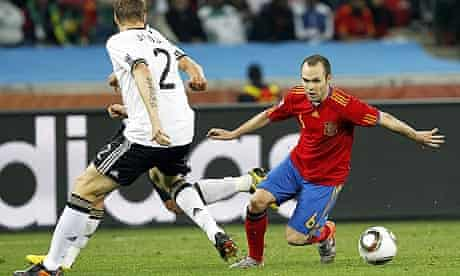 Andrés Iniesta, right, skips past Marcell Jansen during Spain's 1-0 win against Germany in Durban
