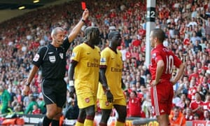 Martin Atkinson shows Liverpool's Joe Cole a red card