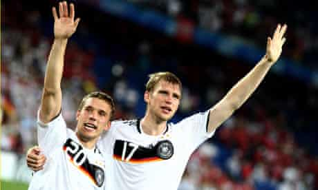 Germany's Per Mertesacker, seen here with Lukas Podolski, is wanted by Arsenal