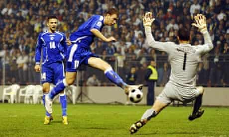 Edin Dzeko, seen here in action for Bosnia, has signed for Manchester City from Wolfsburg for £27m