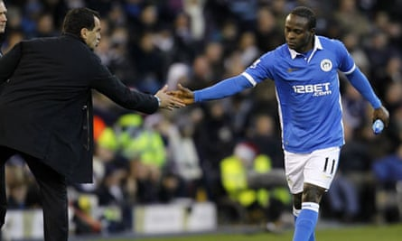 Victor Moses, right, celebrates with Wigan's manager, Roberto Martínez