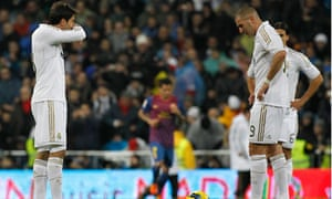 Real Madrid's Kaka, left, and Karim Benzema look dejected after Barcelona's third goal