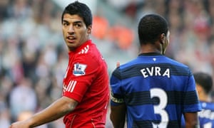 Luis Suárez, left, has been banned for eight matches and fined £40,000 by the Football Association