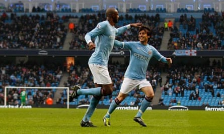 Patrick Vieira celebrates with David Silva after scoring the second goal for Manchester City
