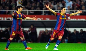 Lionel Messi and David Villa appeal against a decision in Barcelona's draw with Sevilla