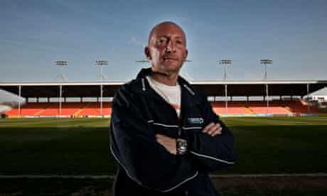 Ian Holloway at Bloomfield Road. He says he is 'totally convinced' that Blackpool can stay up