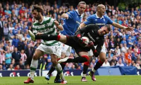 Georgios Samaras collides with David Weir as the goalkeeper Allan McGregor holds the ball tight