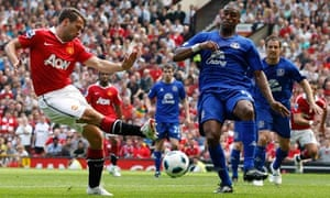 Manchester United's Michael Owen shoots past Everton's Sylvain Distin at Old Trafford
