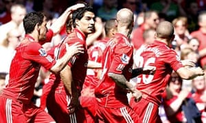 Luis Suárez is congratulated by his team-mates after scoring Liverpool's third against Newcastle