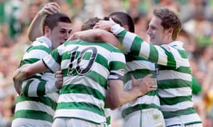 Gary Hooper celebrates with team-mates after scoring Celtic's first goal