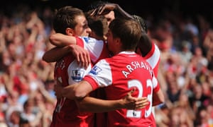 Aaron Ramsey celebrates with his Arsenal team-mates after his goal beat Manchester United