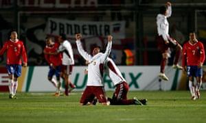 Venezuela players celebrate beating Chile