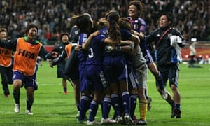 The Japan squad celebrate their victory over USA
