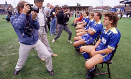 Photographers take photos of the Wimbledon FC players on 15th June 1986