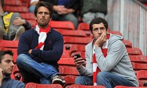 Dejected Arsenal fans