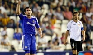 Chelsea's Frank Lampard, left, celebrates his goal in front of Valencia's David Albelda