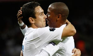 England's Stewart Downing, left, set-up Ashley Young's winning goal