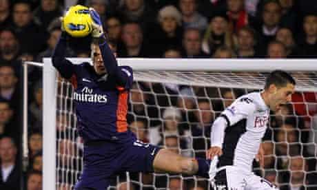 Wojciech Szczesny takes a high ball at Fulham
