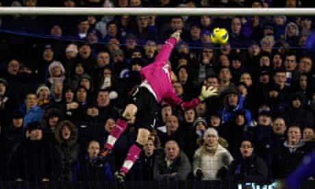 Bolton Wanderers keeper Adam Bogdan is beaten by a clearance by Everton keeper Tim Howard