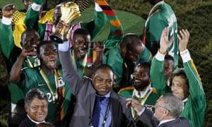 Zambia's Kalusha Bwalya holds the trophy