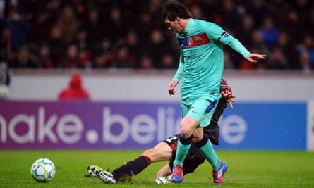 Lionel Messi is denied a goalscoring opportunity by Daniel Schwaab