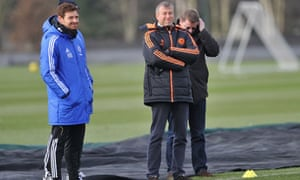 Roman Abramovich, right, watches on as André Villas-Boas takes a Chelsea training session