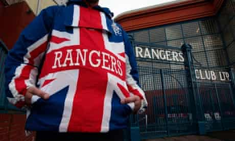 A Rangers supporter at the club's Ibrox stadium