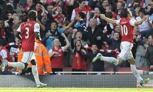 Robin van Persie celebrates scoring Arsenal's second goal against Tottenham