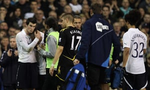 Tottenham and Bolton players leave the field