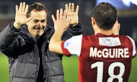 Fleetwood Town manager Micky Mellon celebrates with Jamie McGuire