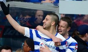 QPR's Adel Taarabt, left, celebrates his goal against Tottenham with Clint Hill