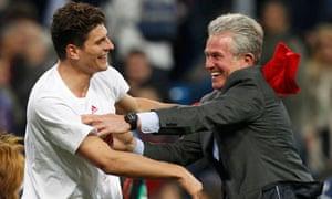 Bayern Munich's coach, Jupp Heynckes, right, celebrates with Mario Gomez