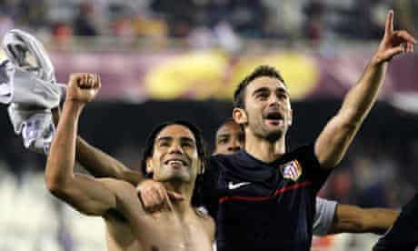 Atlético Madrid's Radamel Falcao, left, and Adrián López celebrate