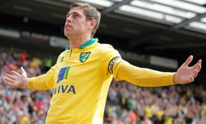 Grant Holt after scoring the first goal for Norwich against Aston Villa at Carrow Road