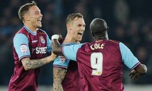 Jack Collison, centre, celebrates after scoring West Ham's second goal against Cardiff