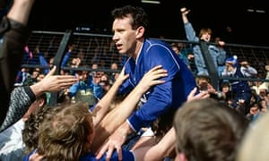 Peter Reid is mobbed by Everton fans as the club clinch the championship.
