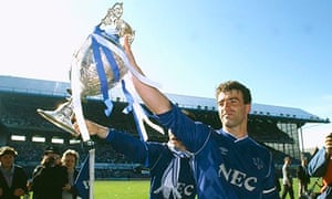Everton central defender and captain Kevin Ratcliffe parades the Division 1 Championship trophy.