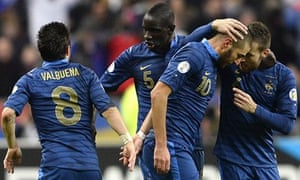 Karim Benzema is congratulated after scoring France's second. Well done everyone.