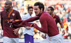 Roma's Mattia Destro removes his shirt as he celebrates scoring the winner against Fiorentina