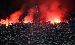 Napoli fans burn flares