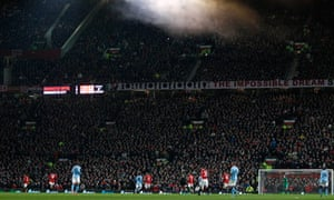 Fans watch Manchester United at Old Trafford