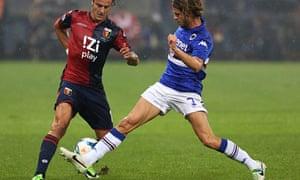 Genoa's Alberto Gilardino, left, is tackled by Sampdoria's Andrea Costa