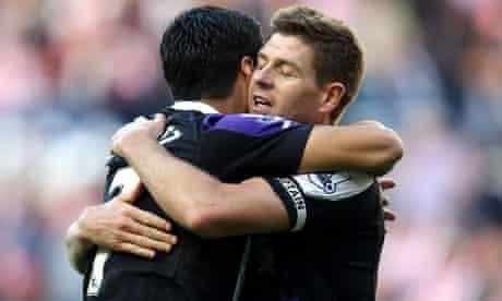 Luis Suárez, left, celebrates scoring one of his two goals at Sunderland with Steven Gerrard