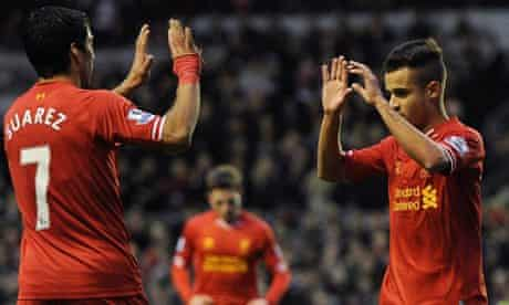 The Liverpool manager, Brendan Rodgers, wants Philippe Coutinho, right, to score more goals